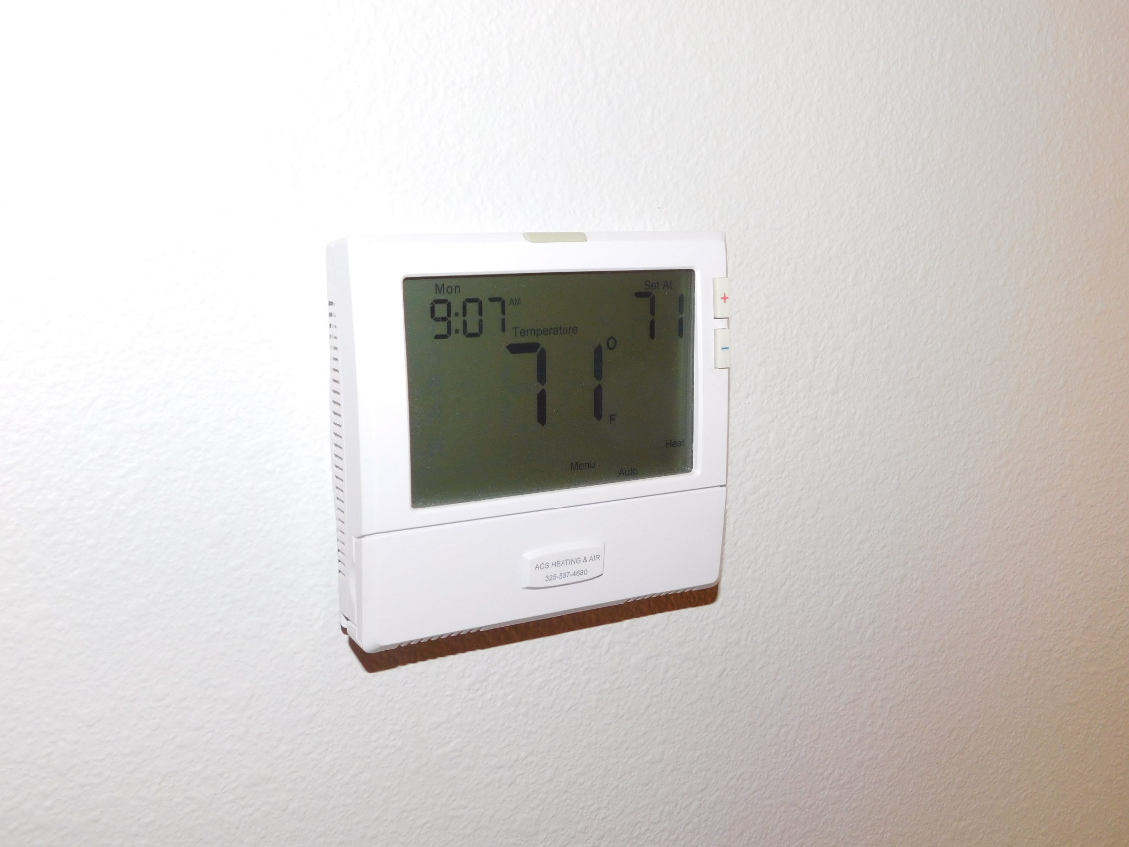 Lower thermostat setting