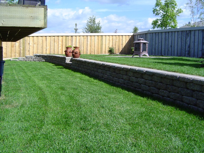 Synthetic Turf Teepee Creek by Brick, Rock and Block Landscaping